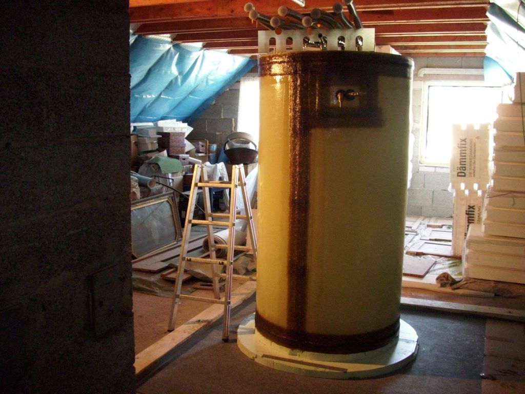 The hot water tank is built in an attic.