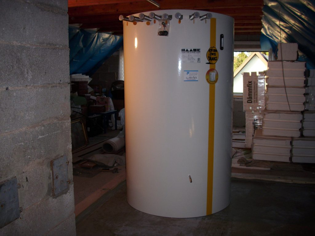 The installed hot water tank in the attic.